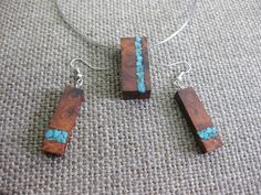 Fine necklace and earrins set made of Amboyna burl and natural turquoise inlay FREE SHIPPING!    Size/Dimensions/Weight for the pendant  height - 1. 3/8 inches / 35 mm width - 5/8 inches / 15 mm weight - 15 gr    Size/Dimensions/Weight for the earrings  height - 1. 3/8 inch / 35 mm width - 7/16 inches / 10 mm weight - 10 gr    Materials utilised Amboyna burl, natural turquoise  Production method 100% hand made by natural materials.    ABOUT ME  My name is Nikolin Georgiev and I live in…