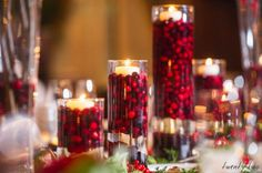 christmas wedding ideas cranberries in clear hurricane candle holder #Centerpieces #Christmas