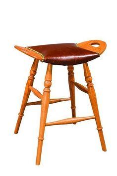 """Saddle Barstool with Leather Seat from DutchCrafters Amish Furniture. Transitional-style barstool with saddle seat. Features four turned legs and leather upholstery on the seat. Available in 24"""" high (for 36"""" counter) or 30"""" high (for 42"""" counter). Great for areas in the kitchen with an overhanging counter or a kitchen island. Made to order in the U.S.A. #barstools #counterheight #kitchenisland #backless #wooden #saddle"""