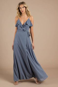We're so grateful we've found the Kristen Slate Wrap Maxi Dress! Featuring a gauzy woven polyester that drapes into a surplice bodice with ruffle deta Women's Fashion Dresses, Sexy Dresses, Evening Dresses, Prom Dresses, Graduation Dresses, Wedding Dresses, Maxi Wrap Dress, Ruffle Dress, Blue Beach Dresses