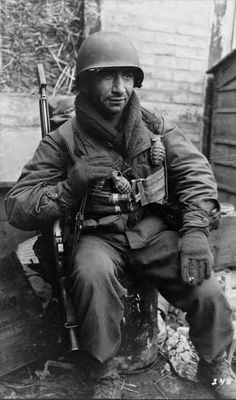 Pvt. Michael Swinkin of Company B, 1st Battalion, 16th Infantry Regiment, 1st Infantry Division, U.S. First Army. Photo taken near the Roer River, Kreuzau, Germany, 25 February 1945.
