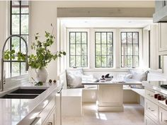 Not only the kitchen . also the windows! The perfect white kitchen nook by Dungan Nequette . I'm thinking angel food cake and milk. Kitchen Nook, New Kitchen, Kitchen Decor, Kitchen White, Eclectic Kitchen, Kitchen With Breakfast Nook, Kitchen Seating, Kitchen Windows, Kitchen Interior