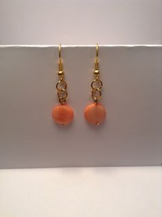 Coral and gold glass beaded dangle earrings by Shaylasjewelrybox on Etsy