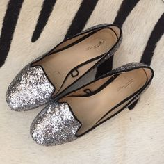 Zarra glitter flats Lightly used flats. Silver glitter and black trim around flat. From Zara basic fall 2012. If you spots where glitter is missing but overall in great condition!  The shoe size says 37, but fits like a 6 1/2. Zara Shoes Flats & Loafers