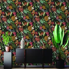 Reverie is a quirky and fun tropical design. It features parrots wearing crowns, chameleons with top hats and bush babies wearing glasses. All are set within bold tropical leaves. Size: x Roll) and Plum in colour. Tier Wallpaper, Purple Wallpaper, Purple Backgrounds, Wallpaper Roll, Wallpaper Toilet, Feature Wallpaper, Bathroom Wallpaper, Tropical Wallpaper, Botanical Wallpaper