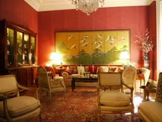 In Triant's living room an 18th century Japanese screen dominates the east wall. The sofa and club chairs are covered in Clarence House fabric.