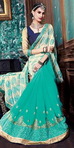 Astounding Green And Cream Georgette Saree.