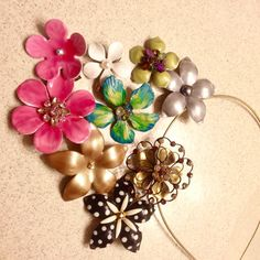 A customer sent me a photo of her collection of Mona Lisa flower clips she purchased at the Ritz Carlton Maui and the Four Seasons Maui resort spa retail area.