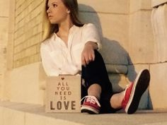 """Senior pictures """"all you need is love"""" & red shoes."""