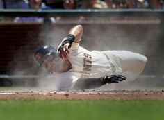 Michael Morse slides into home against the Minnesota Twins in the third game of the series on May 25, 2014 at AT&T Park.