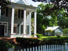 Historic home in St. Marys, Georgia.    Actually this is our house.  Photo taken a few years ago.  It's now gray with an upper porch!  Come see us!