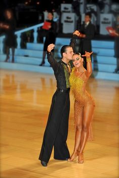 Aww. Cute pose! the dress really shows off her tan, too. #latin #dance #dancesport