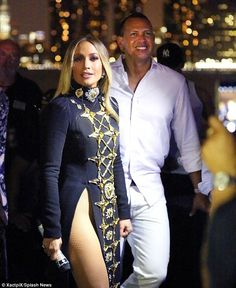 Good-looking pair: Making the most of her timeless natural beauty, J.Lo wore her sun-kissed hair in long waves