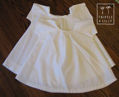 Infant chemises are very simple garments - the sleeves are cut as one piece with the main body and there is a single button closure on the front.