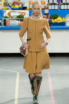 Chanel AW 2014/2015.  I like the style except for the drop shoulders; you have to be a fullback to wear them. IMHO.