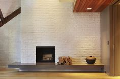 Joseph Vance Architects like the mix of materials and textures, and the hearth that invites sitting.