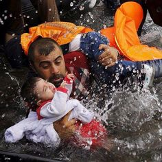A #Syrian refugee man and his two kids.