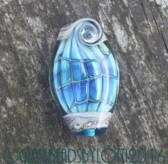 Handmade lampwork focal bead 'Iridescent blue green fish'.  SRA by GlassBeadsbyLotti on Etsy