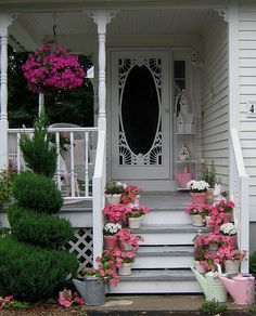 I need a porch like this with lovely pink flowers
