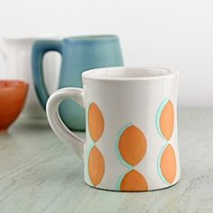 Create a simple and modern pattern on a mug using paint and tape. A perfect idea for a handmade gift!