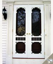 Double Ocean View screen & storm door from our Victorian collection. Installed with brass hardware. Browse more Victorian designs which can be made into double doors like this one.
