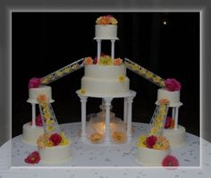 9 tier wedding cake delivered to Castle McCulloch. Buttercream with silk flowers.      www.facebook.com/lilycakes2011