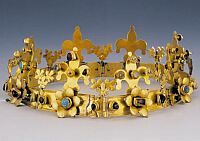 The crown found in Margaret Island  Last third of the 13th century  Gilded silver, amethyst, sapphire, turquoise, pearl  Heigth: 6.2 cm, diameter: 17 cm  Site: Budapest, Margaret Island  Budapest, Hungarian National Museum, inv. no: 1847.43.a The hinges of the crown compacted of eight lilied parts are held together by nails decorated with triple vine-leaf motifs. The lower parts of the lilied elements are decorated with three gemstones (turquoise, sapphire), the central setting is in the…