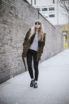 Parka with skinny jeans or leggings with jumper or shirt/blouse and topshop leather cut out shoes.