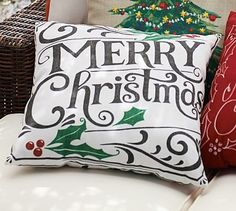 Totally holiday themed and I love it!  Merry Christmas Sentiment Outdoor Pillow #potterybarn