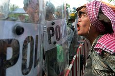 Phnom Penh, Cambodia: a protester shouts slogans in front of riot police blocking a road as the Association of South-east Asian Nations (Asean) summit beginsPhotograph: Tang Chhin Sothy/AFP/Getty Images