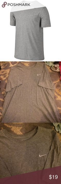 Men's gray Nike athletic cut tee Grey extra large tee with white Nike logo. Little to no wear, worn a few times. Those things that look like dark spots in the photo are shadows Nike Shirts Tees - Short Sleeve