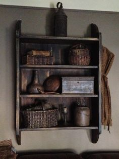 Early shelf with my favorite old leather books and painted baskets