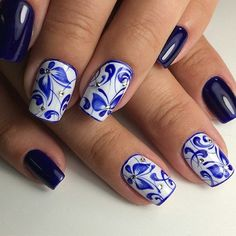 White and Mid Night Blue Nail Art Design. The midnight blue color is always on the board to give out the classy fashion look to your nails. Try this color out in combination with white and some diamonds to get the real royal look in hands.
