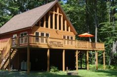 """""""Fish R Landing"""" Vacation rental in Deep Creek Lake.Expansive deck with furniture overlooks private yard with firepit. Windows everywhere to bring the surrounding forest inside with you Minutes from North Lake activities yet abundant privacy and space."""