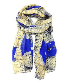 b00fb5ae18cc A vibrant scarf lends the final finish for effortless ensembles. Covered in  an on-trend snakeskin print