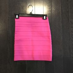 "Pleasure Doing Business 9 band skirt This Fuchsia striped, banded elastic skirt features seam details.  * 14"" long. * Fabrication: Elastic. * 90% polyester/10% rubber. * Hand wash. * Made in the USA. Pleasure Doing Business Skirts Mini"