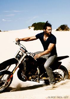....hugh jackman, y u be coasting on your hog in sand. that's what roads are for. silly hugh jackman <3