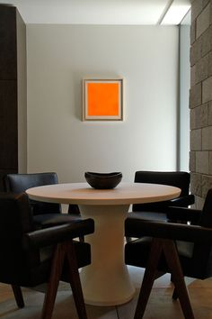Love this setting. The orange painting evokes many images: fireplace, happiness, freedom from form, a meditation focal point, a talking point, Josef Albers.