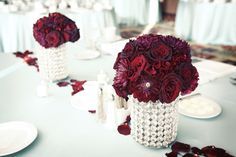 Love the vases the floral arrangements are sitting in! Photo by Randi #MinneapolisWeddingFlorists #WeddingFlowers