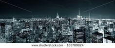 New York City Manhattan skyline at night panorama black and white with urban skyscrapers.