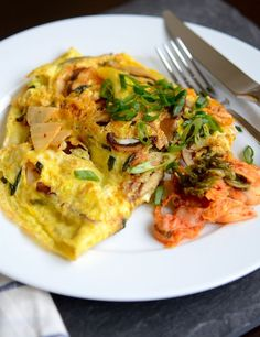 Breakfast for dinner. Those words are like music to my ears. There are many  days in a month when I just feel like having a plate of eggs sunny-side-up  or French toast or a bagel with lox for dinner. (Similarly, a slice of  pizza or leftover pad thai in the morning sounds delicious.)  Last night I was craving eggs with kimchi again. I hadn't made a meal with  that particular combo in a while, but I felt like fortifying myself with an  extra dose of kimchi, seeing how it's good for the…