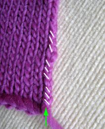 """picking up the correct # of st...You are going to pick up """"V""""s from three rows, then skip the fourth. This will give you the exact proportion of rows to stitches that you need for a collar or front band. This is good to know if you want to deviate from a pattern and add length by adding extra rows. As long as you pick up three rows, skip the fourth, you will wind up with the correct number of sts"""