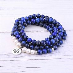 """This bundle features: - Lapis Lazuli Third Eye Chakra Mala - Lapis Lazuli Third Eye Chakra Bracelet Gemstones: Grade """"A"""" Lapis Lazuli Bead Size: 8 mm For more information, check out our Gemstone Grading Chart. Third Eye Chakra, Chakra Bracelet, Lapis Lazuli, Beaded Bracelets, Gemstones, Pearls, Eyes, Pendant, Silver"""