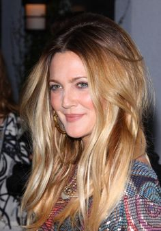 Drew Barrymore - honey blonde with low lights. Nice.