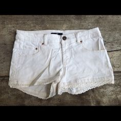H&M shorts. Size 2. H&M cream shorts with lace trim. Size 2. Lightly worn. Make an offer and I'll try my best to work with you to get your poshmark find  H&M Shorts