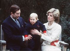 Wilful Will: Princess Diana and Prince Charles keep a firm grip on their furious first-born at a Kensington Palace photo-call