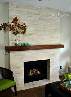 Image result for tile fireplace with floating wood beam mantle