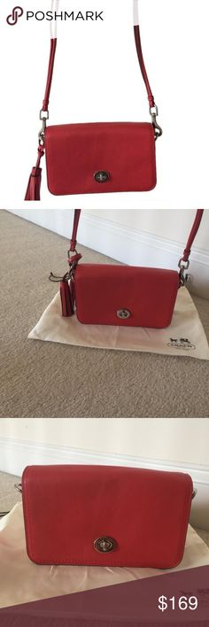 """Coach Legacy leather Penny crossbody bag Coach Legacy Leather Penny Crossbody bag in red/coral color with silver hardware and tassel. It was a gift and only used once. In like new condition. The legacy leather is a high quality soft leather. Comes with the dust bag, box and ribbon like how I received it. 8""""x5""""x2"""" Coach Bags Crossbody Bags"""