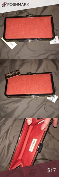 """Coral clutch purse-NEW! Chic yet casual shoulder bag or clutch purse with optional silver chain strap. Linen and cotton fabric in a coral-orange color. 8-1/2"""" X 4-1/2"""". Silver accents. Fabric lined. Lela Rose Bags Clutches & Wristlets"""