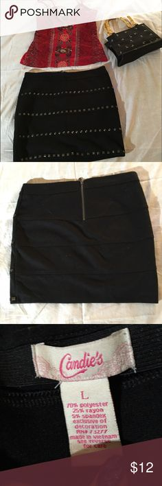 "HP 6/08Black Skirt With Grommets Black skirt by Candies with grommet details on front. Size: L length: 16"". Excellent condition. No trades Candie's Skirts Mini"